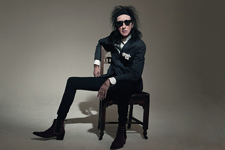 Performance by Dr. John Cooper Clarke
