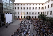 Audience of  Gandules open air cinema at the Pati de les Dones
