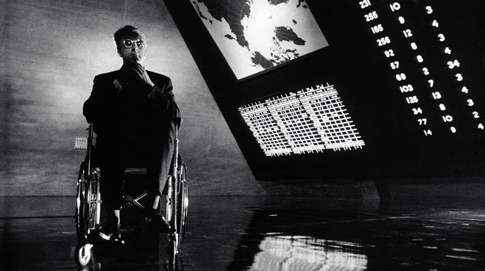 Peter Sellers as Dr. Strangelove in the War Room Film Still © Sony/Columbia Pictures Industries Inc.